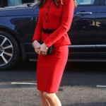 "Kate stunned in a red Lisa Spagnoli suit with bold buttons and peplum detail as she attended the ""The Big Assembly"" event by Place2Be. (Photo: WENN)"