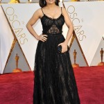 Salma Hayek walked the 2017 Oscars red carpet in a jaw-dropping semi-sheer black lace gown with subtle sequins by Alexander McQueen. (Photo: WENN)