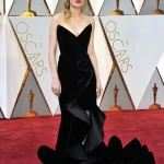 Brie Larson arrived in an Oscar de la Renta black velvet dress with flamenco ruffled train to the 2017 Academy Awards red carpet. (Photo: WENN)