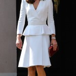 Kate visited the Warsaw Rising Museum in Poland wearing an Alexander McQueen sulk-blend twill peplum coat, dark nude suede pumps, and a red Jenny Packham Casa clutch. (Photo: WENN)