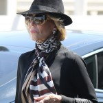 Jane Fonda looked elegant as ever wearing a black suede fedora and a silk scarf. (Photo: WENN)