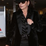 Catherine Zeta-Jones wore an eye-catching all-black outfit, paired with a matching black hat as she arrived the Los Angeles International Airport. (Photo: WENN)