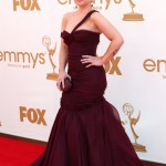 Kelly Osbourne looked spectacular in a full length purple asymmetrical mermaid J. Mendel gown at the 2011 Emmy Awards. (Photo: WENN)