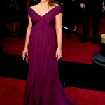 Natalie Portman showed off her growing baby bump as she hit the red carpet at the 2011 Oscars wearing a Rodarte violet silk chiffon draped gown. (Photo: WENN)