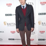 Charlie showed up to the BAFTA Tea Party event wearing burgundy patterned trousers, a matching sweater and shoes, paired with a slimming navy coat, matching tie, and a light blue shirt. (Photo: WENN)