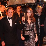 "Prince William protecting his queen, the Duchess of Cambridge, from the rain at the U.K. premiere of ""War Horse."" (Photo: WENN)"