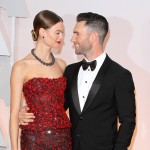 Adam Levine and Behati Prinsloo starring at the love of their life at the red carpet of the Oscars. (Photo: WENN)