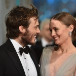"Sam Claflin starring at his real-life ""Rosie"", wife Haddock, at the red carpet of the BAFTA. (Photo: WENN)"