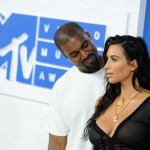 Kanye West feeling proud of his trophy wife Kim Kardashian at the MTV VMA's red carpet. (Photo: WENN)