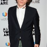 "Charlie Heaton walked down the red carpet of the ""As You Are Premiere"" rocking a flower-printed shirt collar, navy jacket and green plaid pants. (Photo: WENN)"
