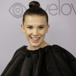 Celebrating her 14th birthday, here are eleven reasons (obvious pun intended) why we are proud members of the ever-growing Millie Bobby Brown Club. (Photo: WENN)