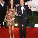 Sir Paul McCartney and Nancy Shevell feeling home thanks to the monsoon weather at the 67th Golden Globes Awards. (Photo: WENN)