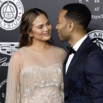 John Legend looking into the eyes of her glowing pregnant wife, Chrissy Teigen. (Photo: WENN)