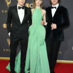 "Charlie kept things single as he walked down the red carpet of the 69TH Emmy Awards in a classic black suit and bowtie as he walked alongside his ""Stranger Things"" co-stars Natalia Dyer and Joe Keery. (Photo: WENN)"