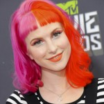 Paramore's Hayley Williams once again went for a bold hairdo with a bi-color pink and orange look at the 2013 MTV Movie Awards. (Photo: WENN)