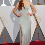 Sophie Turner was totally sustainable at the 2016 Oscars red carpet in a Galvan sage gown with thigh-high slit and Loubuotin heels. (Photo: WENN)