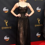 Sophie Turner modelled a black lace Valentino gown with flowing skirt, cinched waist and thin straps—a quite sultry and elegant choice for the 2016 Emmy Awards. (Photo: WENN)