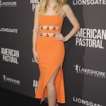 "Fanning stole the show at the ""American Pastoral"" premiere in an orange dress with metal embroidery and asymmetrical fit and flare, by David Koma's Resort. (Photo: WENN)"