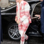 Harry Styles made a statement in a sheer white blouse with a red tartan suit as he arrived at BBC Radio in London. (Photo: WENN)