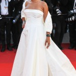 "Rihanna made quite an entrance at the ""Okja"" premiere held during the 2017 Cannes Film Festival, wearing a Dior Haute Couture off white silk taffeta coat and bustier dress, with Andy Wolf Eyewear custom white sunglasses. (Photo: WENN)"