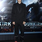 "Harry Styles hit the red carpet at the ""Dunkirk"" premiere in New York City championing black on black, wearing a Calvin Klein suit jazzed up by quirky red embroidery. (Photo: WENN)"