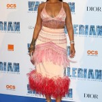 "Rihanna wore a feathered pink Prada dress which consisted of a beaded sating bra paired with a high-waisted pencil skirt to the Paris premiere of ""Valerian and the City of a Thousand Planets."" (Photo: WENN)"