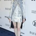 Sophie Turner attended an evening honouring Louis Vuitton and Ghesquiere wearing a fabulous LV ensemble which consisted of a long statement coat with matching mini skirt and a pair of silver sandals. (Photo: WENN)