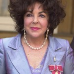 Famous for her many marriages, her violet eyes, her film career, and the possession of a very expensive diamond, Elizabeth Taylor was recognized by Queen Elizabeth when she was named dame in 1999. (Photo: WENN)