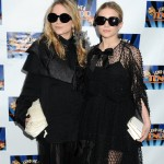 Mary Kate and Ashley Olsen's homeless chic style is often completed with a pair of oversized, dark shades. (Photo: WENN)
