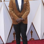 Daniel Kaluuya looked sharp in this nontraditional, caramel-colored velvet Brunello Cucinelli contrast-collar tux jacket, with Tods shoes and IWC watch. (Photo: WENN)