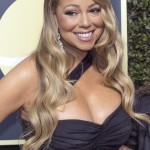 Mariah Carey's left side has always been accentuated by a mole located right next her pout. (Photo: WENN)