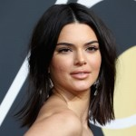 "Acne didn't stop Kendall Jenner from rocking the Golden Globes 2018 red carpet. When a fan praised her confidence, she simply responded ""never let that s**t stop you."" (Photo: WENN)"