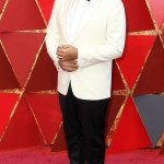 Oscar winner Jordan Peele looked dapper in a crisp white Calvin Klein jacket and poplin shirt with a black satin bow tie and tux pants, and a custom yellow gold antler lapel pin. (Photo: WENN)
