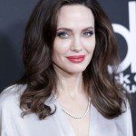 Angelina Jolie received her damehood from the Queen not for her contributions to the arts, but rather for her philanthropic efforts. The honor, however, is honorary, since her American citizenship prevents her from using the title. (Photo: WENN)