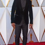 Mahershala Ali also went for the dark green with this fancy velvet jacket paired with a shawl-collar jacket over a monochrome grey shirt and pants. (Photo: WENN)