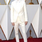 Oscar nominee Timothée Chalamet made the right move on the red carpet with a white-on-white custom Berluit tuxedo, paired with contrasting black boots. (Photo: WENN)