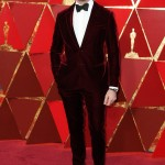 Armie Hammer took a leap away from red carpet predictability in a custom red velvet tux by Giorgio Armani with rose gold cufflinks and watch to complete the look. (Photo: WENN)
