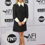 Reese hit the red carpet at the 45th AFI Life Achievement Award Gala Tribute to Diana Keaton in a Miu Miu black mini dress with long sleeves and contrasting white collar and cuffs. (Photo: WENN)