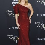 Reese Witherspoon brought glamour to the premiere of A Wrinkle In Time in Hollywood wearing a shimmering rich red one shoulder gown by Michael Kors. (Photo: WENN)