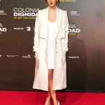 "Emma shined at the premiere of ""Colonia Dignidad"" in an all-white outfit which consisted of a simple mini dress underneath an oversized white coat and matching pumps. (Photo: WENN)"