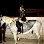 A long lace skirt didn't keep Madonna from climbing atop a horse while in Italy. (Photo: Instagram)