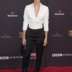 Emma debuted her stylish new bangs at the BAFTA 2018 Tea party, wearing white blazer top and black trousers designed by Osman, paired with black Susi Studio shoes. (Photo: WENN)