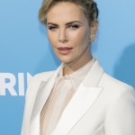 """I got hit in the face pretty hard with depression. Yeah, for the first time in my life I was eating so much processed foods and I drank way too much sugar,"" Charlize admitted. (Photo: WENN)"