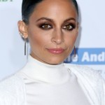 Nicole Richie made dark blue hair look classy with a sleek hairdo and flawless smoky eyes at the Baby2Baby Gala in 2014. (Photo: WENN)