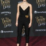 "Emma chose a striking all-black Oscar de la Renta jumpsuit with a dramatic strapless V-neck paired with a gold rose pin at her hip for the ""Beauty and the Beast"" premiere. (Photo: WENN)"