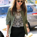 Miranda Kerr was seen heading to a nail salon in Hollywood in a black mini skirt, snake print blouse and a military green jacket to dress down her look. (Photo: WENN)