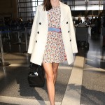 Kerr was photo ready as she arrived at LAX wearing a short floral dress paired with a denim belt with red hem, a white coat, and contrasting big black sunnies. (Photo: WENN)