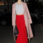 Miranda was spotted enjoying a night out in Paris wearing a red pleaded maxi skirt, paired with a white knitted cropped top and a long blushed toned coat. (Photo: WENN)
