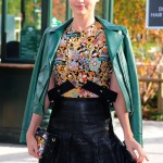 Kerr looked like the model she is in black leather pleaded shirt skirt, graphic colorful top, and green leather jacket over the shoulders as she walked around the streets of Paris. (Photo: WENN)