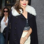 Miranda looked chic as she walked the streets of New York City in high waisted white trousers, a black tube top with graphic designs, and a black coat with sheepskin collar. (Photo: WENN)